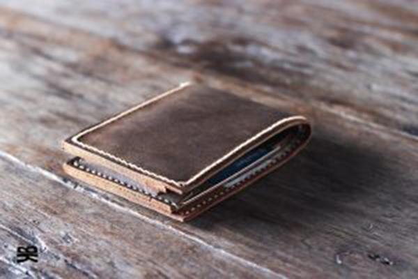 ví da cao cấp nam, Lịch sử hình thành của chiếc ví da cao cấp nam